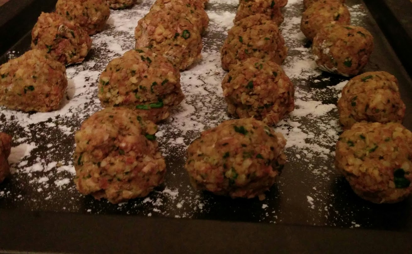 Falafels rolled into balls ready to be fried